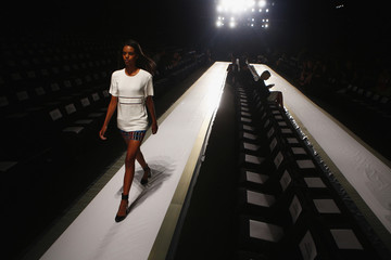 A model rehearses before Herve Leger by Max Azria Spring/Summer 2014 collection show during New York Fashion Week