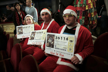 """People dressed in costumes attend the draw of Spain's Christmas Lottery """"El Gordo"""" in Madrid"""