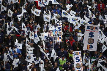 Police march as they take part in a demonstration against budget cuts and hiring freeze in Madrid