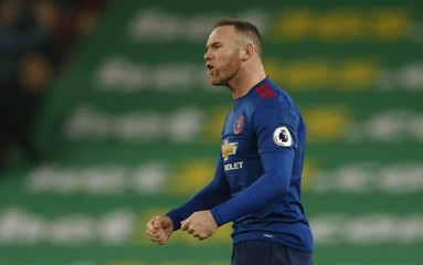 Manchester United's Wayne Rooney celebrates scoring their first goal to break the all time goalscoring record for Manchester United