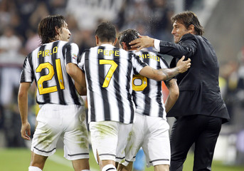 Juventus's Marchisio celebrates with coach Conte after scoring against AC Milan during their Italian Serie A soccer match in Turin
