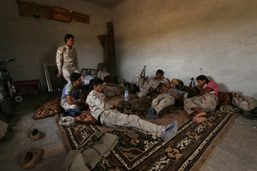 Syria Democratic Forces (SDF) alliance fighters rest in a safe house in southern rural Manbij