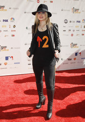 """Australian musician Orianthi poses at the """"Stand Up To Cancer"""" television event aimed at raising funds to accelerate innovative cancer research at the Sony Studios Lot in Culver City, California"""