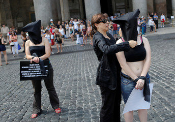Amnesty International activists take part in a performance to protest against enforced disappearance in downtown Rome