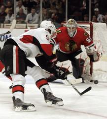 Senators Michalek shoots on Blackhawks Crawford during their game in Chicago