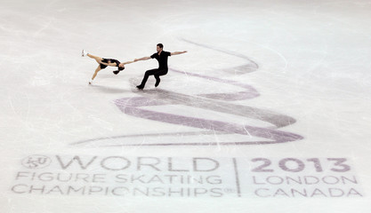 Castelli and Shnapir of the United States perform in the pairs short program at the ISU World Figure Skating Championships in London