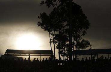 Spectators watch a match at the Australian Open tennis tournament in Melbourne