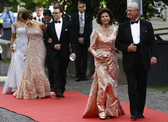 Sweden's King Carl XVI Gustaf and Queen Silvia Crown Princess Victoria and her fiance Daniel Westling arrive for a Government dinner at the Eric Ericson Hall in Skeppsholmen