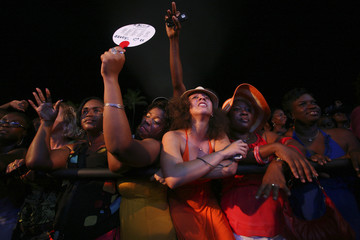 Fans of U.S. vocalist, songwriter and producer R. Kelly react during his performance at the St Lucia Jazz and Arts Festival in Pigeon Island National Landmark
