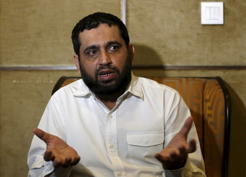 Sajid Usmani, project manager for Bahria Icon Tower, gestures during an interview with Reuters at his office in Karachi