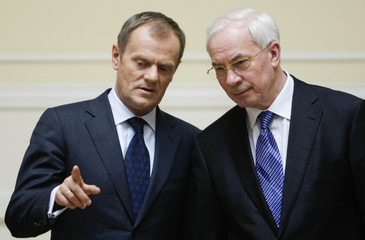 Polish Prime Minister Donald Tusk makes a point during his meeting with Ukrainian Prime Minister Mykola Azarov in Kiev