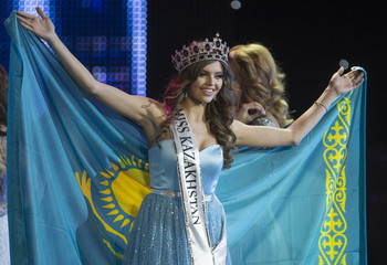 Regina Vandysheva poses with a national flag after winning the 2014 Miss Kazakhstan national beauty contest in Almaty