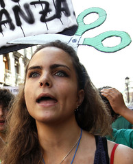 A secondary school student shouts slogans in favour of public schools as she takes part in a demonstration against proposed budget cuts in public education in central Madrid
