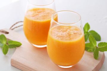 Delicious orange smoothie in a glass.Selective focus,オレンジスムージー ミント
