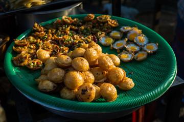 Burmese Street Snack. Dough balls sold as popular street snack in Kyaukme night market, Shan State, Myanmar.