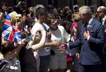 Britain's Prince Charles greets the crowd during a walkabout in Saint John