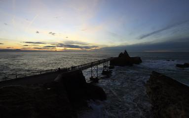 Visitors walk along the Port des Pecheurs (The Fisherman's Port) along the Basque coast of Biarritz, southwestern France