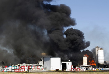 Fire burns at the Magnablend Inc. chemical storage site in Waxahachie, Texas