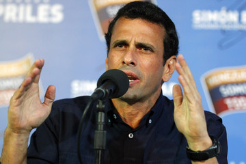 Venezuela's opposition leader Henrique Capriles talks to the media during a news conference in Caracas