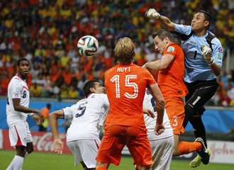 Costa Rica's Navas punches the ball clear during their 2014 World Cup quarter-finals against the Netherlands at the Fonte Nova arena in Salvador