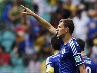 Bosnia's Dzeko celebrates after scoring a goal during their 2014 World Cup Group F soccer match against Iran at the Fonte Nova arena in Salvador
