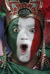 Fan makes funny faces before the start of the 2010 World Cup Group A soccer match between France and Mexico at Peter Mokaba stadium in Polokwane