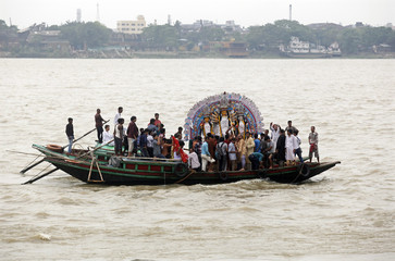 An idol of Hindu goddess Durga is transported on a boat for immersion in the waters of river Ganges on the last day of the Durga Puja festival in Kolkata