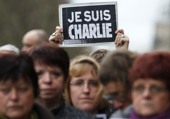 """A person holds a placard which reads """"I am Charlie"""" during a minute of silence in Strasbourg for victims of the shooting at the Paris offices of weekly satirical newspaper Charlie Hebdo on Wednesday"""