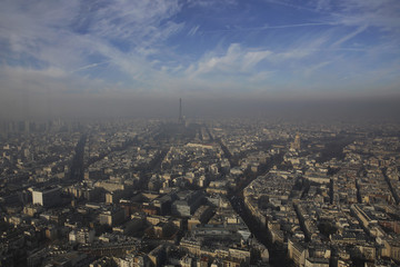 The Eiffel Tower is seen through a small-particle haze resulting in a high level air pollution index according to Airparif, the air quality monitoring agency, in Paris