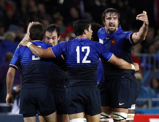 France players celebrate after winning their Rugby World Cup semi-final match against Wales at Eden Park in Auckland