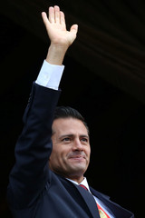 Mexico's President Pena Nieto waves during a military parade celebrating Independence Day at Zocalo Square in downtown Mexico City