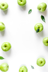 natural food design with green apples frame white desk background top view mock up