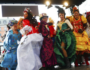 Female market traders celebrate traditional 'Dance of the Market-Women' carnival event in Munich