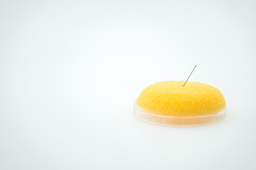 Sewing needle over white background