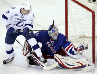 New York Rangers' Henrik Lundqvist gloves a save in front of Tampa Bay Lightning's Alex Killorn during their NHL game in New York