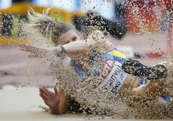 Hryshutyna of Ukraine competes in the women's long jump qualifying round during the 15th IAAF World Championships at the National Stadium in Beijing