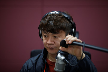 Kim Chung-seong, a North Korean defector and a Christian missionary, adjusts a microphone during a radio broadcast at a radio station in Seoul