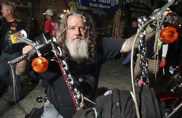 A biker known as Wild Bill, parks his bike at Suck Bang Blow biker bar in Murrells Inlet