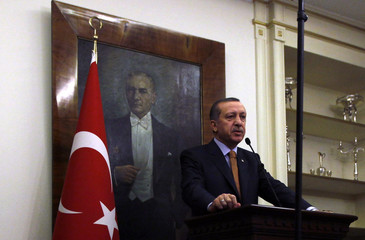 Turkey's Prime Minister Tayyip Erdogan, with a portrait of modern Turkey's founder Ataturk in the background, speaks during a news conference in Ankara