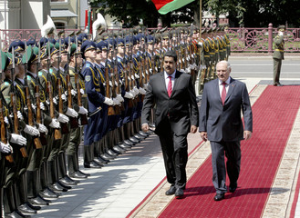 Venezuela's President Maduro reviews an honour guard with Belarus President Lukashenko during his visit to Minsk