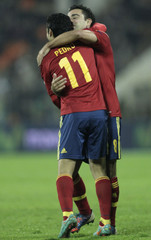Spain's Pedro celebrates with teammate Xavi after scoring a goal against Belarus during their 2014 World Cup qualifying soccer match in Minsk