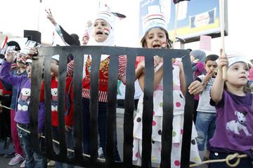 Syrian children living in Jordan shout slogans against Syria's President Bashar al-Assad during a protest outside the Syrian embassy in Amman