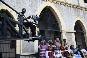 A cameraman films a scene from a crane during the making of 'Ake', in Abeokuta, southwest Nigeria