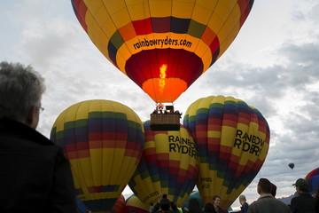 Attendees watch and take pictures as hundreds of hot air balloons lift off on the first day of the 2015 Albuquerque International Balloon Fiesta in Albuquerque, New Mexico