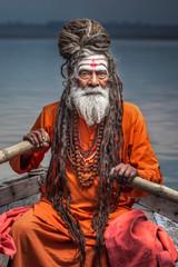 Portrait of sadhu rowing in the boat, Varanasi, India.