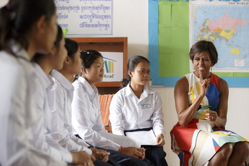 U.S. first lady Michelle Obama gestures as she speaks to students during a visit to promote girls' education at a high school on the outskirts of Siem Reap