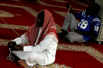 A worshipper holds prayer beads after the Friday prayers at the Hassan II Mosque in Libreville