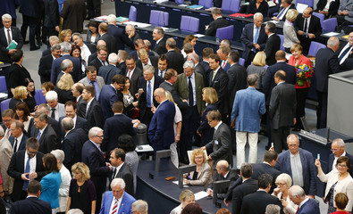 Deputies vote during the session of Germany's parliament, the Bundestag, in Berlin