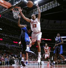Bulls center Noah reaches for a rebound over Mavericks shooting guard Carter during the second half of their NBA basketball game in Chicago