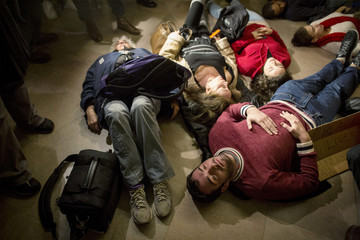 Demonstrators stage a 'die-in' in a protest against the grand jury decision in the Eric Garner case during rush hour at Grand Central Terminal in New York